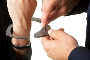 bigstock-man-unlocking-handcuffs-that-b-12187205